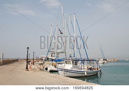 AGISTRI, GREECE - MAY 12, 2016: Small boats moored at Milos harbour on the Greek island of Agistri. Less than an hour from Piraeus, the small island is a popular destination for Athenians.