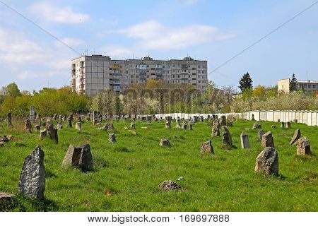 tombstones at jewish cemetery on the road