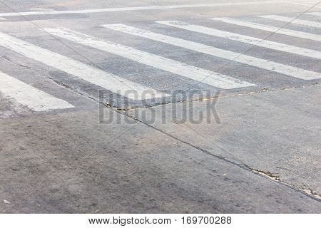 Crosswalk On The Asphalt Road