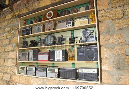 Old vintage radio and alarm clocks on the shelf