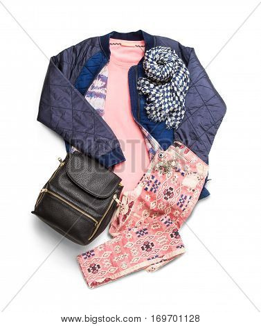 Composition with a jacket, a backpack, a scarf and pants