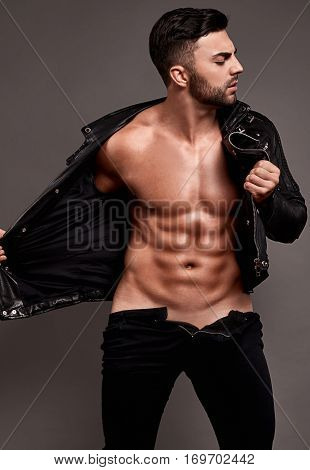 Muscular Brutal Handsome Man In Leather Jacket