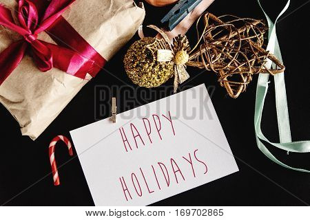 Beautiful Simple Present In Craft Paper With Ribbons, Greeting Card And Toys, Happy Holidays Text