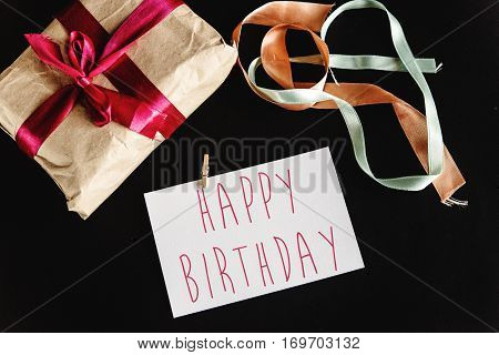 Beautiful Simple Present In Craft Paper With Various Ribbons And A Greeting Card, Happy Birthday Tex