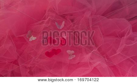 hearts aspire on a red background. Concept of love St. Valentine's Day lovers. Flat fly Valentine's Day Love