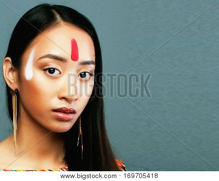 beauty young asian girl with make up like Pocahontas, red indians woman long hair
