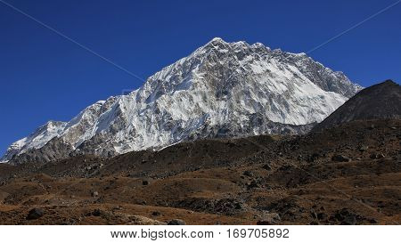 Scene on the way to the Everest base camp. Mount Nuptse high mountain of the Himalayas.