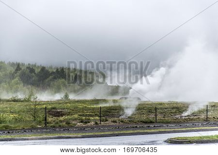 The Great Geysir Strokkur in Iceland hot fog geology