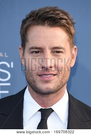 LOS ANGELES - DEC 11:  Justin Hartley arrives to the Critics' Choice Awards 2016 on December 11, 2016 in Hollywood, CA