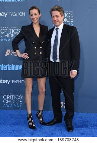 LOS ANGELES - DEC 11:  Hugh Grant and Anna Elisabet Eberstein arrives to the Critics' Choice Awards 2016 on December 11, 2016 in Hollywood, CA