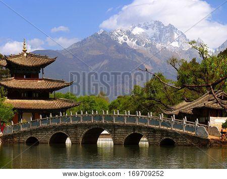 Black Dragon Pool And Jade Dragon Snow Mountain (yulongxui Shan) In Lijiang, Yunnan Province Of Chin