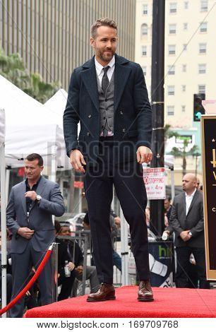 LOS ANGELES - DEC 15:  Ryan Reynolds arrives to the Walk of Fame honoring Ryan Reynolds on December 15, 2016 in Hollywood, CA