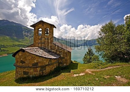 Small country chapel along lake in French Alps. Location is above Beaufort.