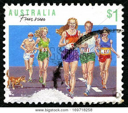 AUSTRALIA - CIRCA 1989: A used postage stamp from Australia depicting an illustration of people running - promoting Fun Run events circa 1989.