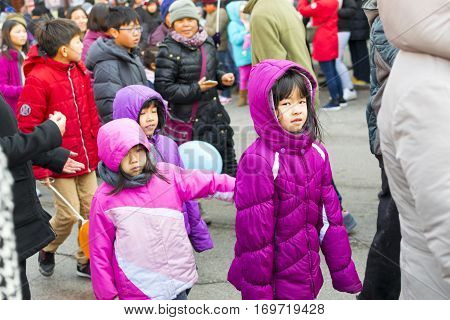 Chicago IL United States - February 5 2017: Chinese children participate in Chinese New Year's Parade in Chinatown in Chicago IL.