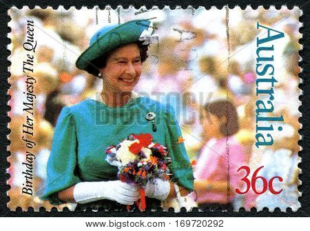 AUSTRALIA - CIRCA 1987: A used 36 cent postage stamp from Australia depicting a portrait of Queen Elizabeth II - commemorating her 61st birthday circa 1987.