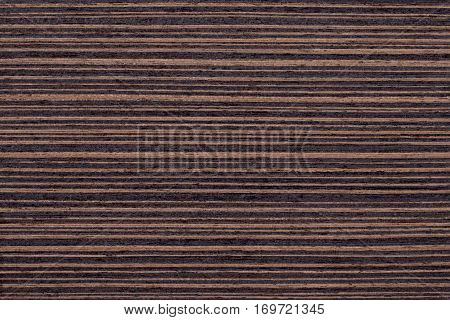 Texture of brown wenge veneer wood background