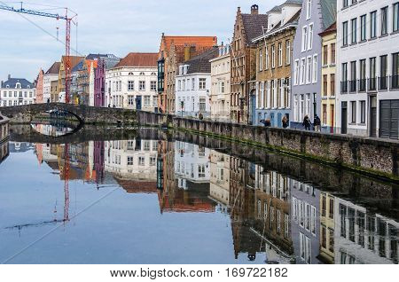 Reflection In The Canal In Bruges, Belgium
