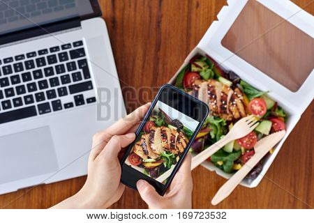 Someone taking a photo of healthy take away takeout lunch with mobile cell phone