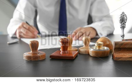 Stamps and ink pad on notary public table