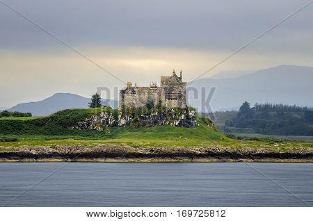 Duart Castle on green hill Isle of Mull Scotland