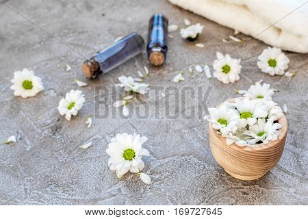 organic cosmetics with camomile on stone background.