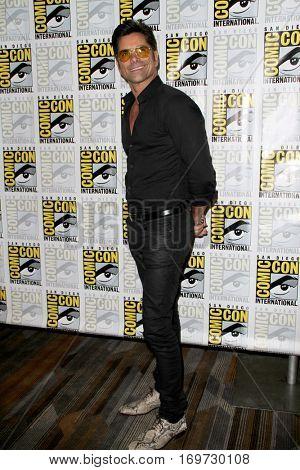 John Stamos arrives the