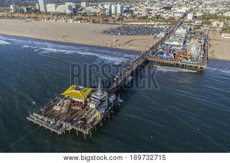 Santa Monica, California, USA - December 17, 2016:  Aerial of Santa Monica pier and beach on the Pacific Coast.