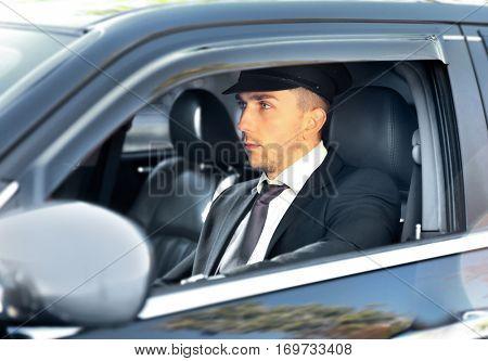Chauffeur driving a car, closeup