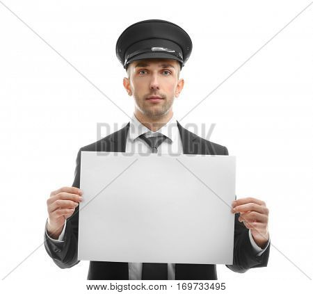 Young chauffeur holding white board on white background