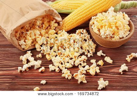 Tasty traditional popcorn on wooden background