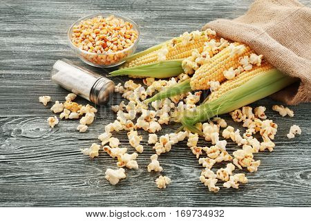 Tasty traditional popcorn on grey wooden background