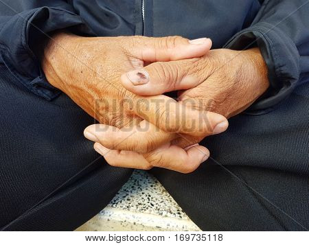 closeup hands of asian old man clasped together
