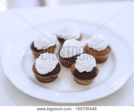 Close-up view of cup cakes on plate