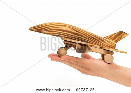 hand holding an airplane model on white concept of airlines ensurance and security