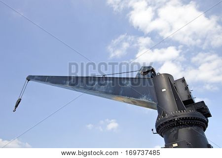 Black construction crane from below