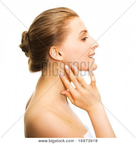 Young adult girl applying moisturiser cream. Healthcare concept.