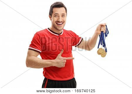 Happy football player holding gold medals and pointing isolated on white background