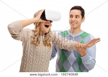 Overjoyed woman using VR goggles with a guy holding her hand isolated on white background