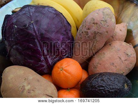 Organic cabagge bananas apples potatoes yams sweet potatoes tangarines avocados