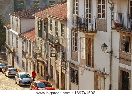 White houses in a steep, sunlit street of the old part of Santiago de Compostela in Galicia, Spain -  2 October 2007