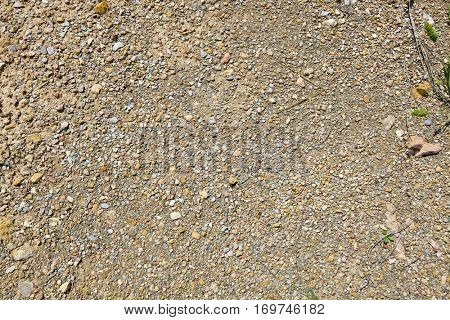 Small stones, gravel, and red dirt