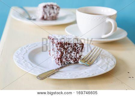 Traditional Australian Lamington sponge cakes with tea