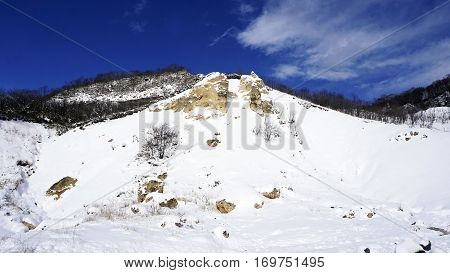 Noboribetsu onsen snow mountain bluesky hell valley winter national park in Jigokudani Hokkaido Japan