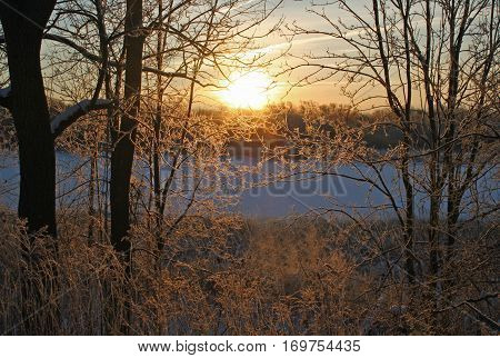 Watching a wintery sunrise on the Grand River