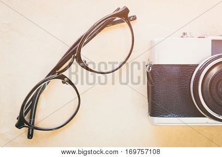 old vintage style camera and black glasses