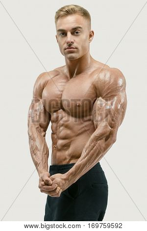 Athletic Man With Strong Abs And Core Muscles