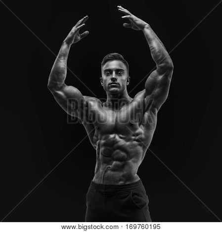 Shirtless Male Bodybuilder With Muscular Build Strong Abs Showing Rising Hand