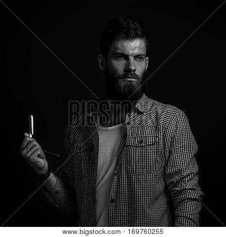 Portrait Of Bearded Man With Straight Razor
