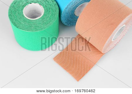 Special physio tape rolls on white background, closeup